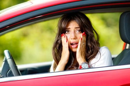 upset woman in car